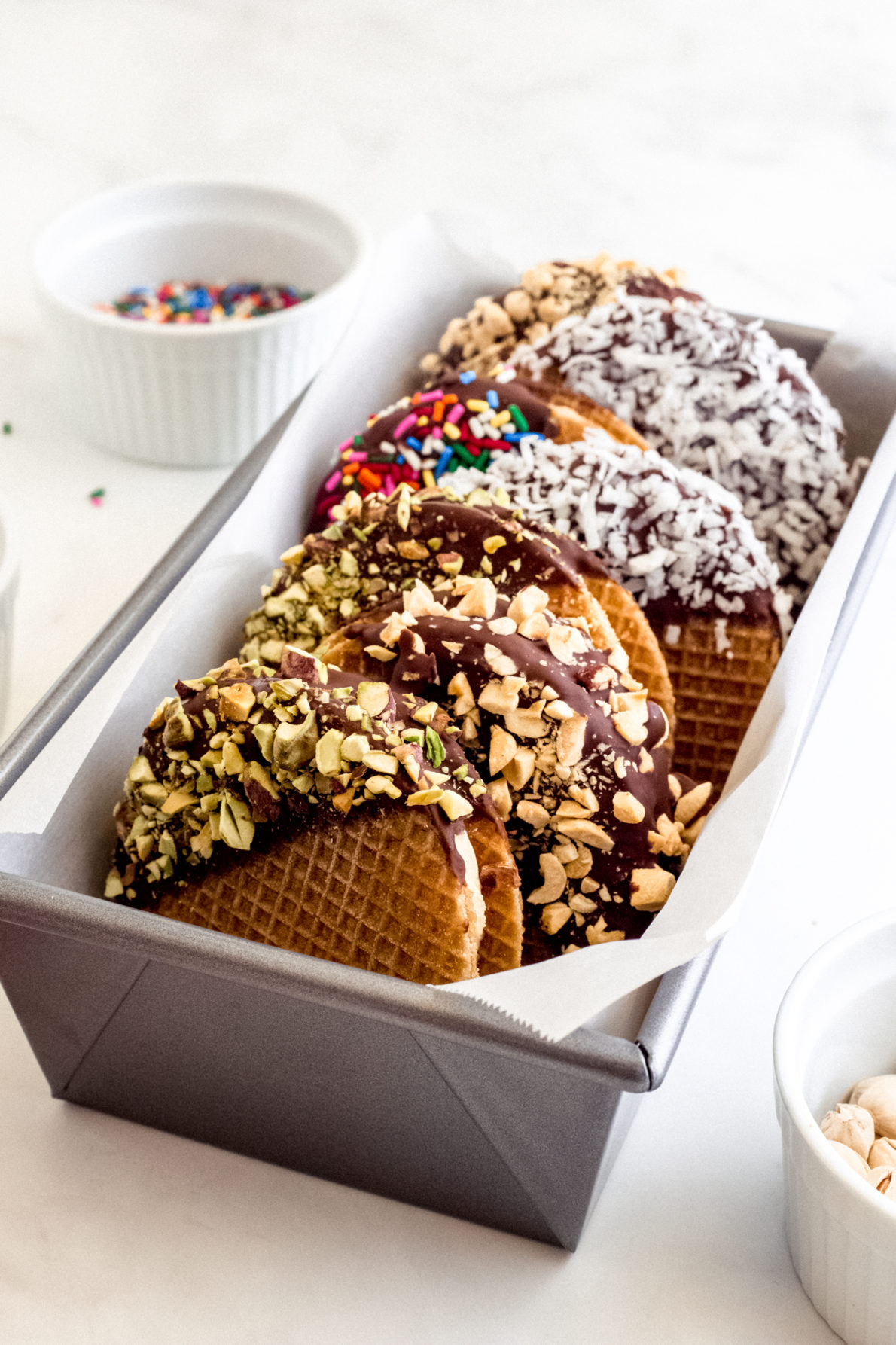 A loaf pan filled with stroopwafel ice cream sandwiches.